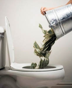 pouring a bucket of money into the toilet